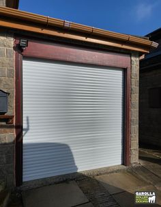 Roller Shutter Doors for sale from Garolla  come in a variety of shades. With auto roll garage doors you can enter your garage in style. Click the link to see our aluminium garage doors.  #garagedoorideas #garagedoordesign #garagedoordecor #garagedoormakeover #garagedoorpaint #garagedoorcolours #garagedoorcolour #electricgarage #electricgaragedoor