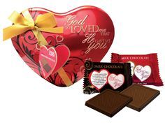 "Introducing our new chocolate filled heart tin for Valentine's Day! This beautifully embossed heart-shaped tin is filled with 3.5 oz. of assorted milk and dark chocolates. Each piece is individually wrapped in the ""God So Loved Me That He Gave Me You"" theme and a love scripture. The tin is embellished with an elegant bow and hang tag. This makes a great Valentine's Day gift!"