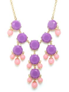 Regal, royal, extravagant and elegant, this statement necklace is an absolute knockout. It's crafted from a grand array of light violet and powder pink  gemstones intricately arranged in a chandelier pattern. Talk about happily ever after.