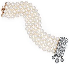 Gold, blackened silver, diamond and pearl bracelet by JAR, Paris. The 4-strand bracelet features 68 cultured pearls. The blackened silver clasp is reverse-set with 30 round diamonds (approximately 9.00 carats) and pavé-set with numerous single-cut diamonds. Via Diamonds in the Library.