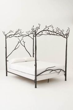 Forest Canopy Bed.    Slumber in an enchanted wood and dream of ancient incantations as hand-forged iron branches cast their leafy net high above your head. Sold at Anthropologie.