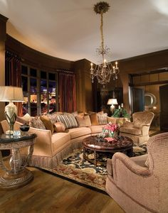 Opulence & luxury are the bold statements of this room from the bullion skirted conversation sofa & the gold & silver leafed finishes to the rich colors of the pillow & chair fabrics