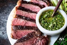 Cooking steak is hard. Cooking Sous Vide Steak with Chimichurri Sauce and Grilled Scallions couldn't be easier! Sous-vide cooking provides consistently great results EVERY SINGLE TIME! Steak With Chimichurri Sauce, Sous Vide Cooking, Strip Steak, How To Cook Steak, Steak Recipes, Coriander, Cilantro, Food, Minute Steak Recipes