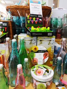 Coloured bottles and wine stoppers at Austins Newton Abbot