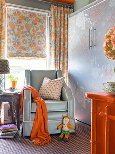In this nursery-slash-guest room, designer Brian Patrick Flynn covered the Murphy bed with wallpaper that coordinates with the fabric and furnishings.