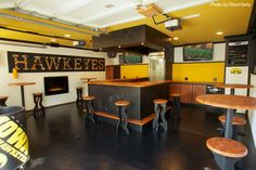 This may look like a closed bar, but any die-hard Iowa fan would welcome this design in their basement. #iowa #hawkeye #basement