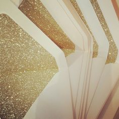 http://www.etsy.com/listing/158666410/mint-and-gold-glitter-letterpress?ref=sr_gallery_20_search_query=glitter+wedding+invitation_order=most_relevant_view_type=gallery_ship_to=ZZ_page=2_search_type=handmade - I love the sparkle!