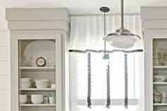 Bridge the gap between ceiling and upper cabinets with a handsome molding treatment. This built-up cornice is easy to DIY using paintable clear pine or poplar 1x6 boards. | Photo: Laurey W. Glenn |  thisoldhouse.com