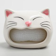 Crafted of ceramic with a painted finish, our happy cat sponge holder adds adorable feline friends to your sink areas. This unique and spacious holders have room for multiple sponges.