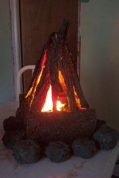 Great Indoor Campfire Idea - styrofoam rocks, silk flames, tree bark and a small fan.