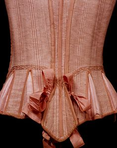 Stays and busk        Place of origin:        England (probably, made)      Date:        1660-1670 (made)      Artist/Maker:        Unknown (production)      Materials and Techniques:        Pink watered silk (English or Italian), backed with linen, stitched with pink silk thread and reinforced with whalebone      [Stays] Edged and decorated with pink silk grosgrain ribbons with tinned iron points      Credit Line:        Given by Miss C. E. Gallini      Museum number:    V&A,    T.14-1951