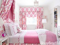 This pink bedroom was decorated with Lee Jofa Belgravia fabric. Bed linens by Chez M'Lain. Floor lamp by Two Worlds Arts.