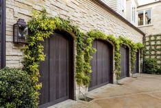 love the evergreen clematis surrounding these garage doors