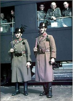Two armed men (probably a pair of Hungarian police) standing in front of a train bearing German troops headed to Balkan campaign. Luftwaffe, Trains, Central And Eastern Europe, Ww2 Photos, Afghanistan War, Austro Hungarian, Rare Images, German Army, Colorful Pictures