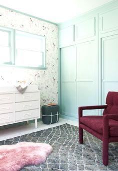 Mint green walls and wallpaper in nursery