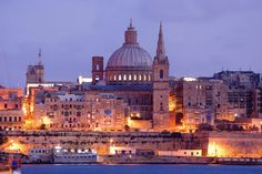 Valletta is just animated by day and by night, with buildings steeped in history. Built out of steep rock, the city of Valletta demands that visitors hike to appreciate its heritage and culture, Valletta, Malta. Beautiful Islands, Beautiful Places, Malta Valletta, Malta Island, Walled City, Palace Hotel, Vacation Deals, World Cities, Fortification