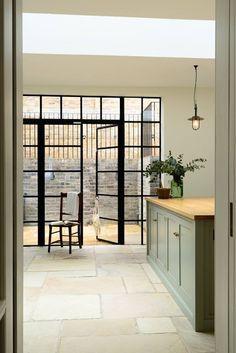 Modern Country kitchen Modern Country Kitchens, Modern Country Style, English Kitchens, Stone Flooring, Kitchen Flooring, Stone Walls, Crittal Doors, Crittall Windows, Steel Frame Doors
