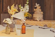 vintage medicine bottles wrapped in yarn, milk glass vases and pinwheels
