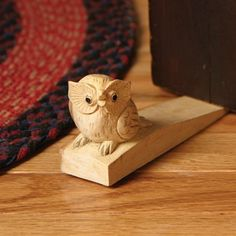 Whoo's there?! Let this hooting owl hold the door for you! It is hand-carved in natural suar* wood and comes with non-toxic finish. - Handmade in Indonesia - Dimensions: 2.5 in. height x 5.75 in. widt