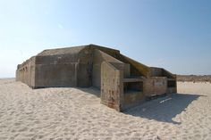 """World War Two Bunker, Cape May, New Jersey - In its heyday, the bunker was manned by a group of military men who spent their long days and nights scanning the oceans for signs that Axis forces were encroaching on the US borders. The bunker, once outfitted with fully stocked powder rooms and shell rooms, generators and 8"""" guns, saw the surrender of a German U-Boat one time in the war."""