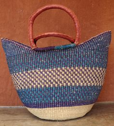 Patterned shopping basket with leather-bound handles,