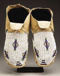A PAIR OF ARAPAHO BEADED HIDE MOCCASINS c. 1880