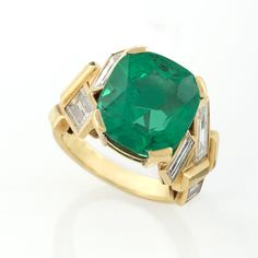 Colombian Emerald and Diamond Gold Ring by Suzanne Belperron A French Mid 20th Century 18 karat gold ring with emerald and diamonds by Suzanne Belperron. Circa: 1955-1969