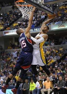 Paul george pacers probasketballindianapacers warrior and a indiana pacers paul georgeright goes up for a dunk on atlanta hawks al voltagebd Image collections