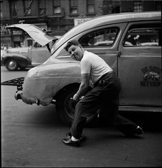 A taxi driver changes a tire in 1940s NY. Shot by Stanley Kubrick