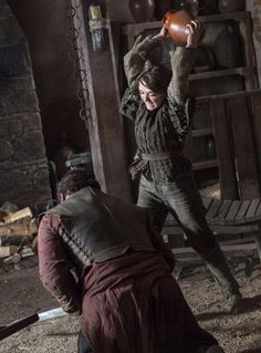 Arya smashing a pot on a guys head, because come on, it just doesn't get any better than that :)