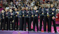 Aug 11, 2012; London, United Kingdom; Members of team USA stand during the playing of the national anthem after defeating France in the women's basketball gold medal game in the London 2012 Olympic Games at North Greenwich Arena. Mandatory Credit: Richard Mackson-USA TODAY Sports