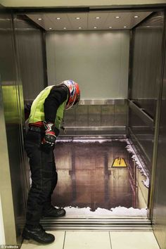 Imagine calling the lift, the door opened to reveal this deep, yawning lift-shaft. Alton Towers, Wandsworth, London.
