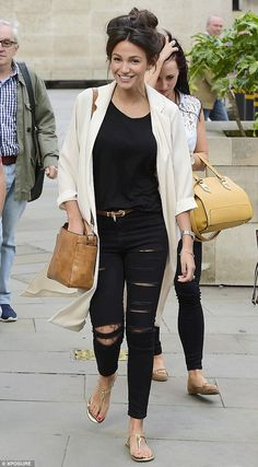 Stunner: Michelle Keegan, 28, continued to flaunt her fashion prowess as she was seen leaving the BBC studios in London on Thursday, all the while having a giggle with her mates