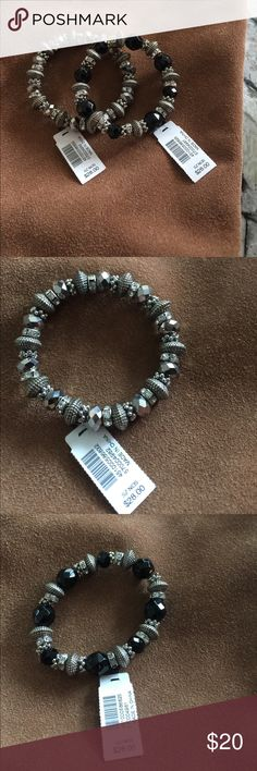 NWT WHBM stretch beaded bracelet. Set of two White House Black Market bracelets.  These have never been worn.  I had a set and got one for Christmas so selling new pair.  One has black beads the other is silver. White House Black Market Jewelry Bracelets