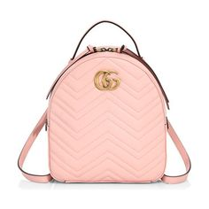 gg marmont chevron quilted leather mini backpack by Gucci. The GG Marmont backpack has a softly structured shape and Double G hardware, inspired by an archival design. The doub...