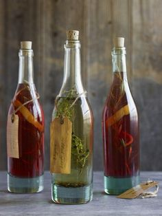 Do-it-Yourself: Infused Vinegar | 1 1/2 cups fresh basil leaves or thyme, tarragon or rosemary sprigs    4 cups white wine or Champagne vinegar    1 clove garlic, thinly sliced    2 lemon zest strips, each 1 inch wide and 2 inches long