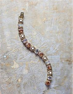 Autumn Haze Bracelet -  Seed pearls and cut crystal are encased in burnished metalwork of brass and bronze.