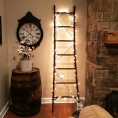 Used an old antique ladder I purchased at an estate sale. Such a great find. Only $25 bucks.  A Hobby Lobby clock and Jack Daniels whiskey barrel.