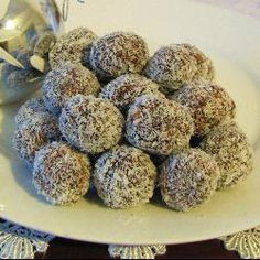 chocolate coconut balls - milk arrowroot biscuits, cocoa powder, coconut, sweetened condensed milk. easy and yummy