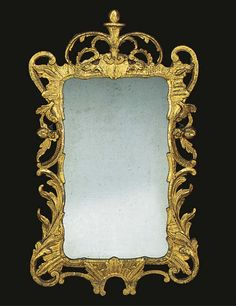 AN IRISH GEORGE III GILTWOOD MIRROR  THIRD QUARTER 18TH CENTURY The recangular later plate in a pierced rockwork and foliage frame surmounted by pierced scrolling foliage.