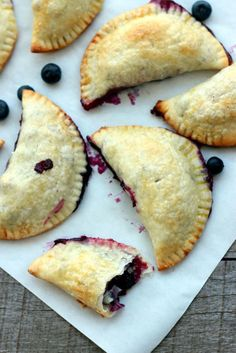 These hand pies are bursting at the seams with lemony blueberry filling—the perfect to-go treat for your next picnic. Get the recipe at Dish by Dish. - CountryLiving.com