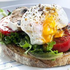 Filling  and Lite Breakfast Recipes ... I would use spinach or kale with this poached egg sandwich!