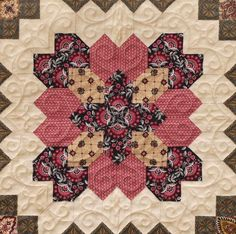 A prizewinning Lucy Boston - Patchwork of the Crosses quilt. Quilted with another set of designs from www.houseofcreations.biz. More details and photos on House of Creations website