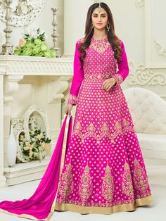 Spirited pink taffeta wedding wear designer anarkali suit. Having fabric taffeta, silk, santoon and nazneen. The ethnic embroidery work, resham embroidery work, zari work, cording work, stone work and zari border for the attire adds a sign of magnificence statement with a look. Comes with matching bottom and dupatta. #mydesiwear #AnarkaliSuits #Silk #SalwarSuits #OnlineShopping #FloorLengthAnarkali #PunjabiSuits #PartyWearSalwarSuits #AnarkaliSalwarKameez #BuyWeddingSuits #WeddingTrendz
