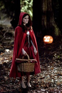 """Little Red Riding hood costume. I have always imagined this as a red German dirndl dress. Perhaps it is because my ancestors were running around 18th century Germany with the last name """"Wolf"""". : )"""