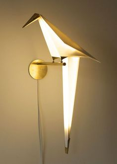 Perch by artist Umut Yamac is a unique wall lamp inspired by the traditional Japanese art of origami. Made from rice paper fitted with brass trimmings, the claws of the origami bird are what complete. Creative Lamps, Unique Lamps, Unique Lighting, Wall Lighting, Modern Lighting Design, Cool Lamps, Origami Lights, Origami Lamp, Origami Birds
