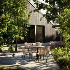 California firm Walker Warner Architects has transformed a warehouse into a tasting room for a winery with redwood, cypress and rammed earth. Wooded Landscaping, Off White Walls, Rammed Earth, Tasting Room, Interior Exterior, Art Design, Architecture, Cladding, Outdoor Spaces