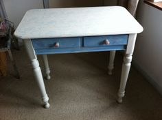 Autentico chalk-painted table. The surface is decorated with a flowery design.