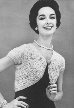 Shrug -- often knit or crochet / sweater-type garment that is very cropped and rounded with a small closure at the sternum