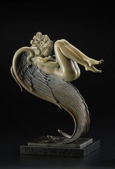 """""""Angel of August"""" in 2011 by Michael Parkes (Sikeston, Missouri 1940). Bronze (19x12x6.5 inches). American-born artist living in Spain who is best known for work in the areas of fantasy art and magic realism. He specializes in painting, stone lithography and sculpture. his style is realistic in principle, but often uses magical subject matter."""